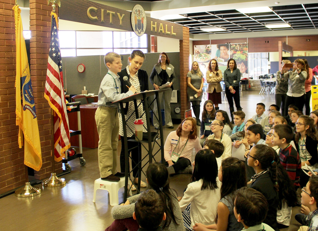 "(above) ""Mayor"" Jonah Segal addresses Central School fifth graders during a visit on Feb. 26 to JA BizTown, a hands-on, simulated business community in Edison offered by Junior Achievement of New Jersey."
