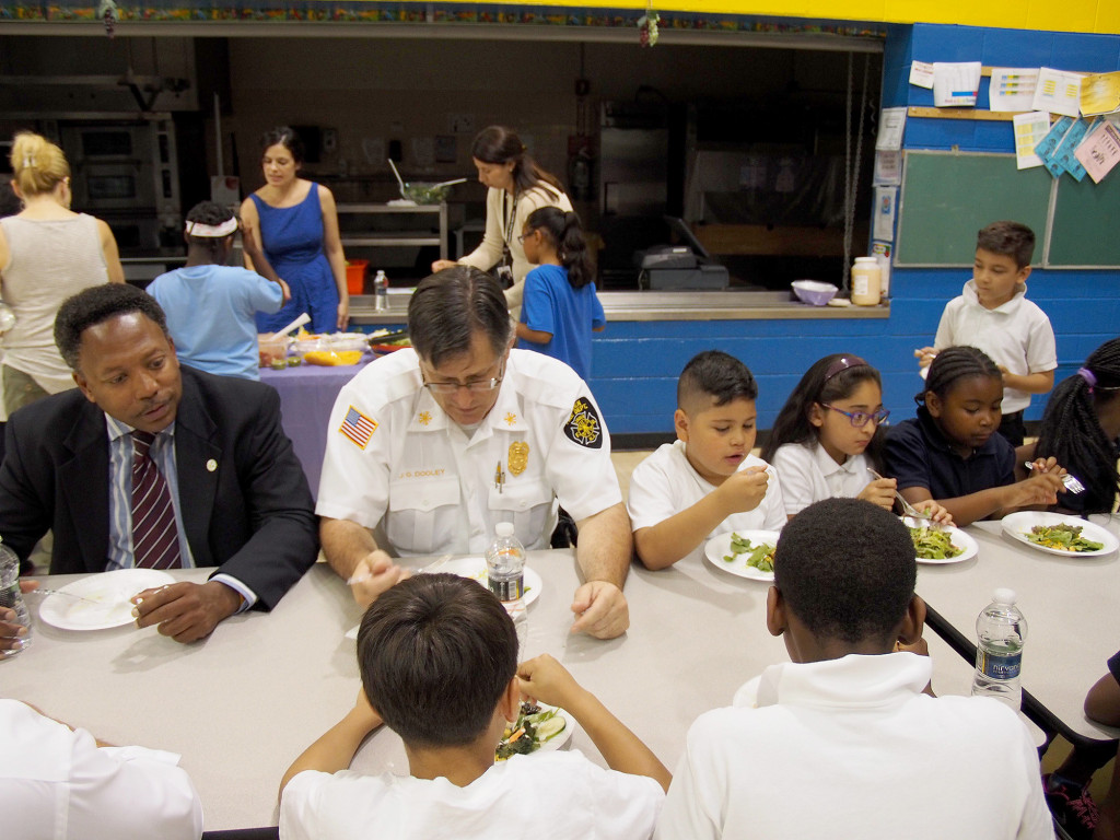 """(above) Linden Mayor Derek Armstead, Linden Fire Chief Josheph Dooley, Nicholas Herrera, Aylin Acosta, and Aamira Williams eat their """"Friendship Salad"""" together and discuss the importance of healthy eating habits."""