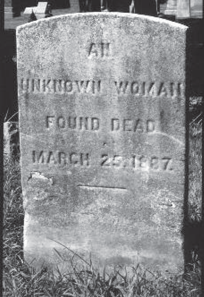 (above) The cold, stark headstone at the grave of the Unknown Woman.
