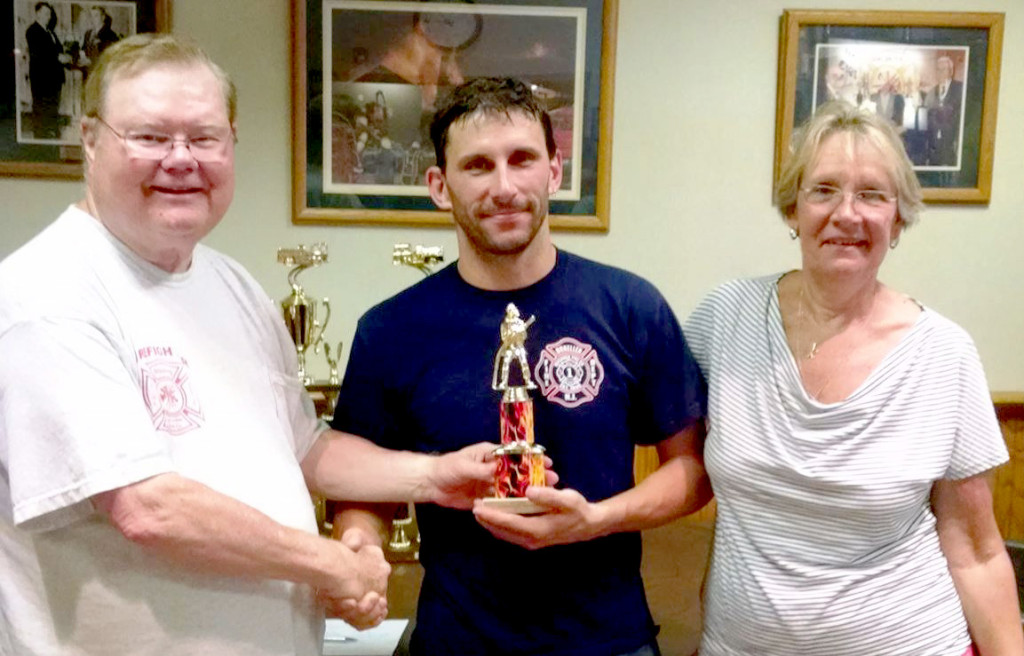 Dunellen Fire Dept's Rich Freyer is presented with the 4th place trophy by race chairman and former Dunellen firefighter Frank Reilly and Burn Center Foundation director Kathy Conlon.