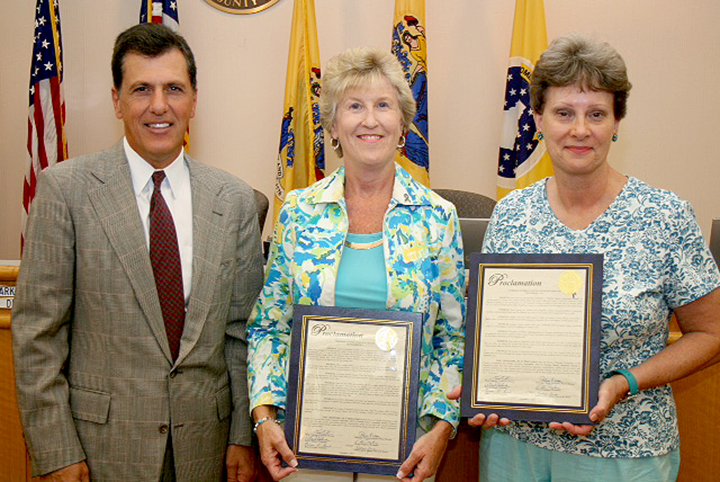 Lynn Stahl (center) and Lynn Franklin (right) receiving Proclamation Declaring September as Ovarian Cancer Awareness Month in Somerset County from Somerset County Freeholder Mark Caliguire.