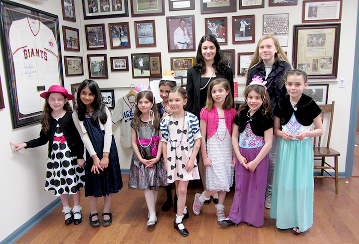 (above Front Row, l-r)Troop 65004 Reese Fishelman, Giya Parikh, Nicole Dahl, Isabella Posado, Garance Lesegretain, Hannah Stefanovic, Julia Biviano, Bridge Biviano. (Back Row, l-r): Gianna Tautonico and Annika Schmidt.
