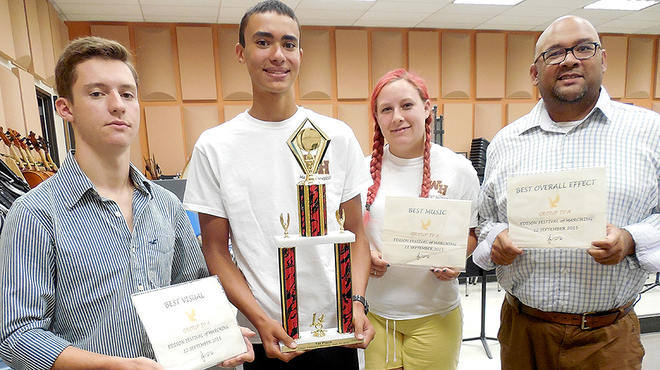 "The Watchung Hills Regional High School Marching Warriors Band won first place in their class of schools, and fourth place overall, at the U.S. Bands-sponsored band competition held on Saturday, Sept. 12, at Edison High School, Edison Township. From left are: Senior Tuba player John Ray of Warren Township, who is also the band's Brass Captain; Sophomore Tuba player Ethan Marmolejos of Watchung; Junior Clarinet player Amelia Stepperfenne of Millington; and new Band Director Minesh Shah. The Marching Warriors Band can be seen performing at all home football games, and their program this year is organized under the theme, ""A Night with Netflix,"" and features music from the movies, ""Captain America,"" ""The Lion King"" and ""Slumdog Millionaire."""