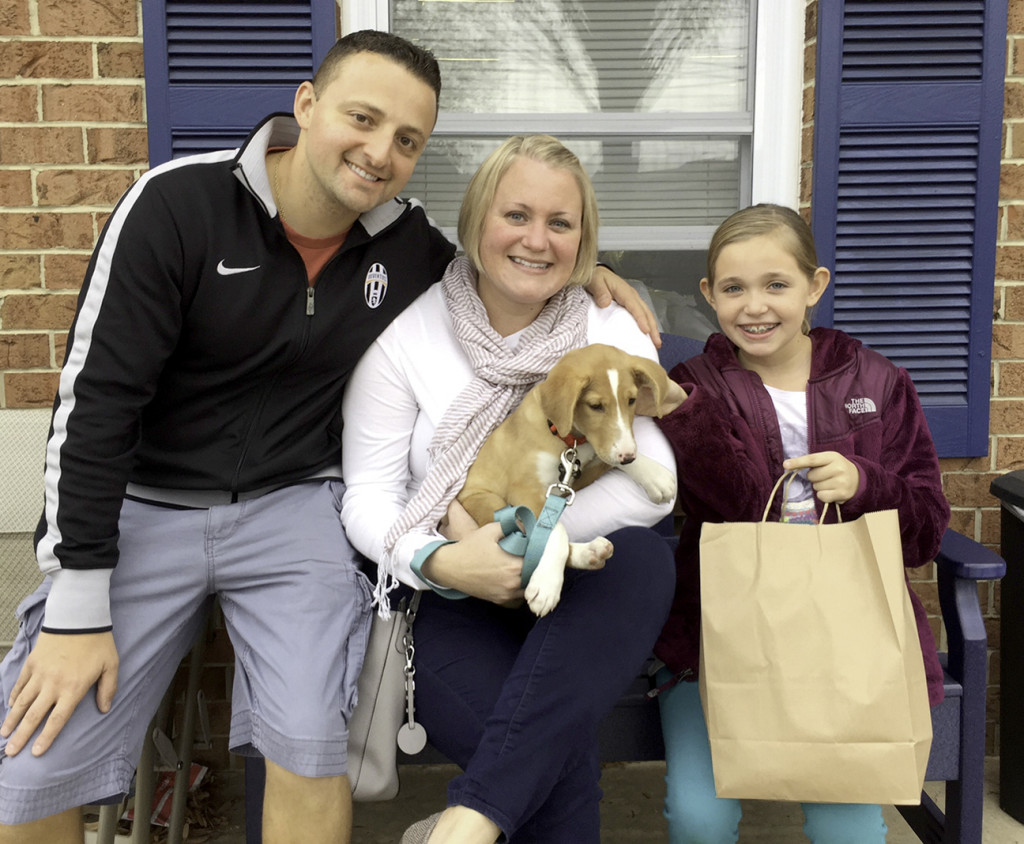(above) Enrico and Keri Perrone of Madison became the latest benchmark adopters in Home for Good Dog Rescue's five-year history.