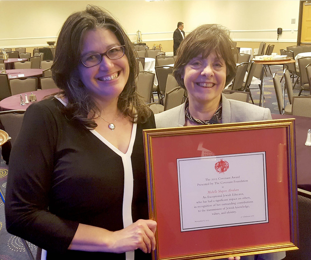 (above, l-r) Temple Sholom member and Fanwood resident Michelle Shapiro-Abraham proudly showcases the Covenant Award for Excellence in Jewish Education she received from the General Assembly of the Jewish Federations of North America. Temple Sholom Past President Sandra Nussenfeld nominated Shapiro-Abraham for the award, which was presented at a dinner in Washington D.C.