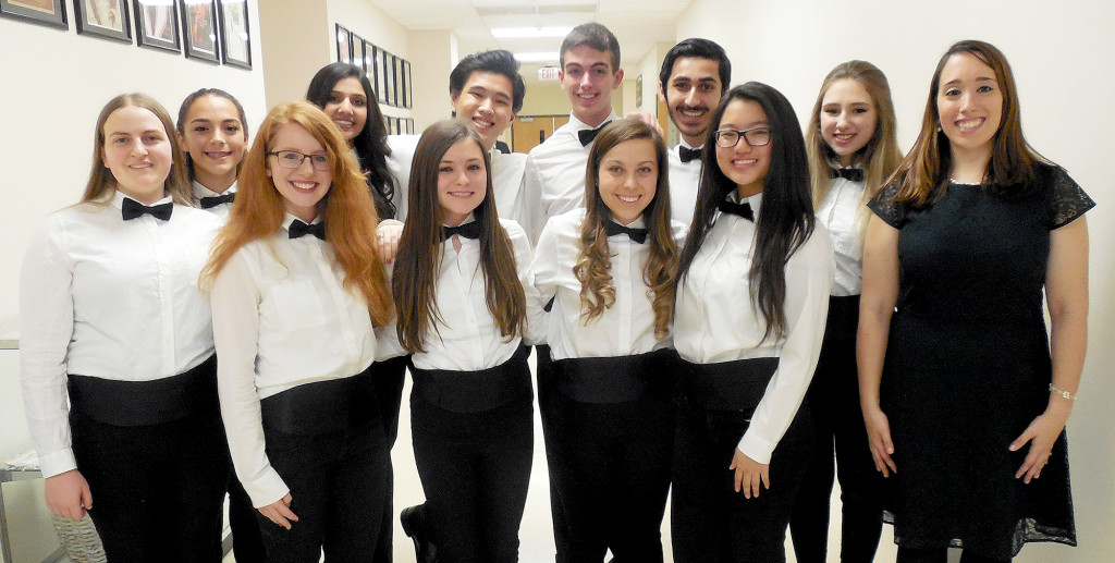 (above) Eleven student singers at Watchung Hills Regional High School have earned appointment to the New Jersey School Music  Association (NJSMA) Central Jersey Regional Chorus. Gathered after participating in the Winter Choral Concert Friday, Dec. 18, at Watchung Hills Regional High School, are Choral Music Teacher Angela DiIorio Bird, front row left, and Central Jersey Regional Chorus members, front row, from left, Kira Leinwand, Angela Celeste, Kyra Anthony, Allison Horvath and Veronica Mu; and back row, from left, Angie Carrano, Anchal Dhir, Eric Bautista, David Kalwicz, Nikhil Bhat, and Hannah Melillo.