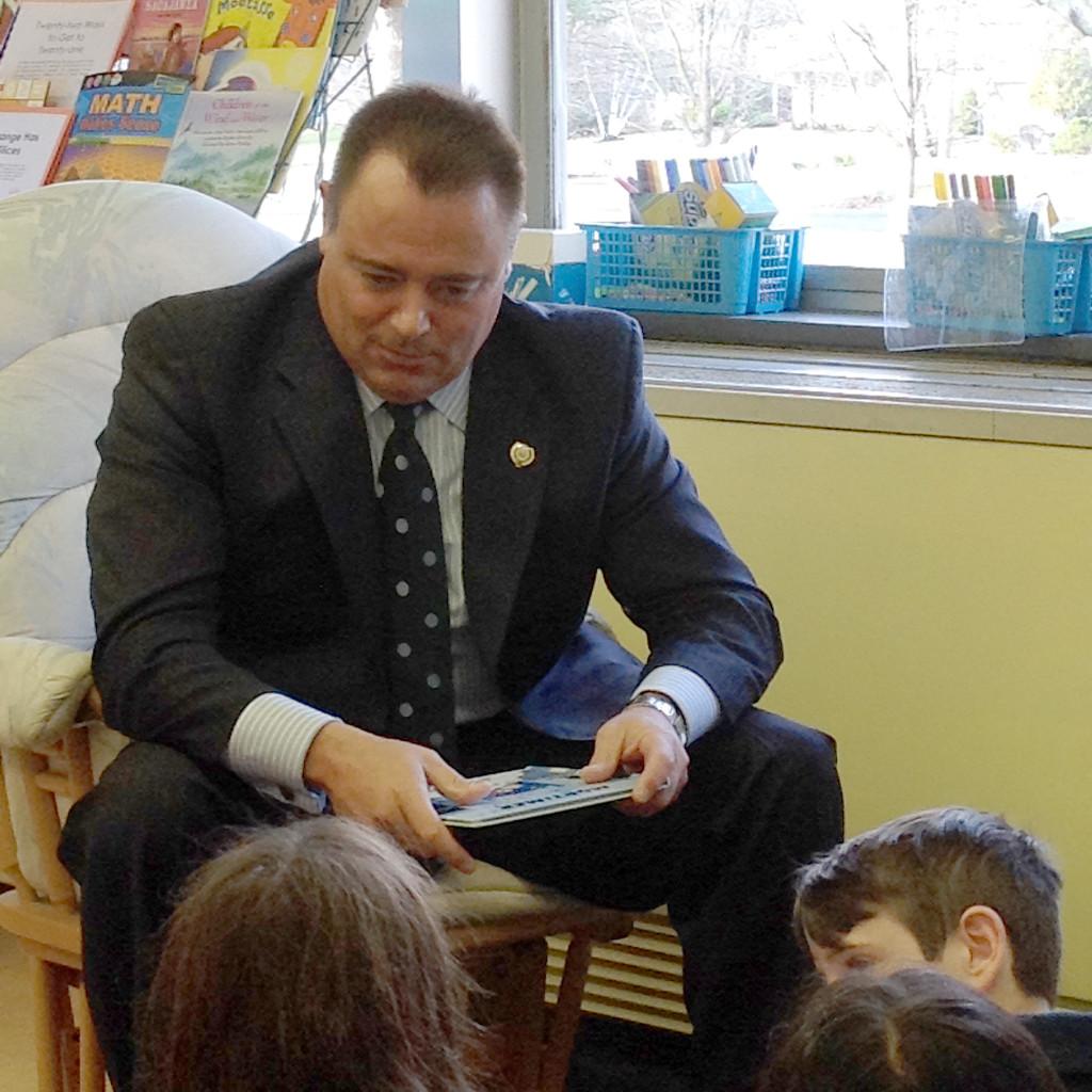 (above) Fanwood Police Chief Trigo reading to a third grade class.