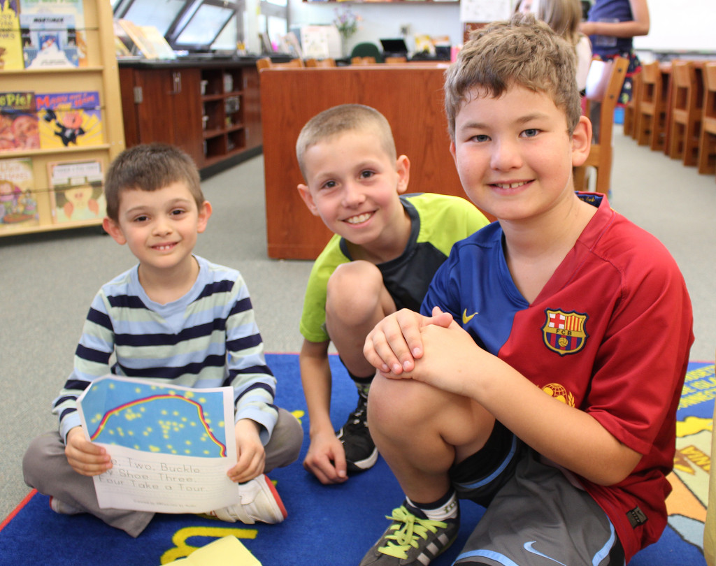 "(above) Kindergartner Aydin Cakirdas (L) shares his poem with fourth grade ""buddies"" Robert Battiste (middle) and Alexander Skiadas ® on National Poem in Your Pocket Day."