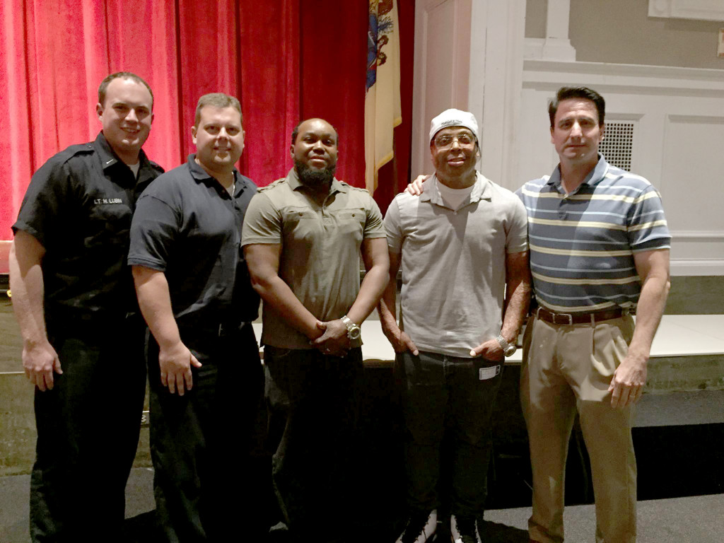 (right) Seton Hall fire survivors Shawn Simons and Alvaro Llanos with Lt. Matthew Lubin, Chief Czeh, and Police Chief Wozniak.