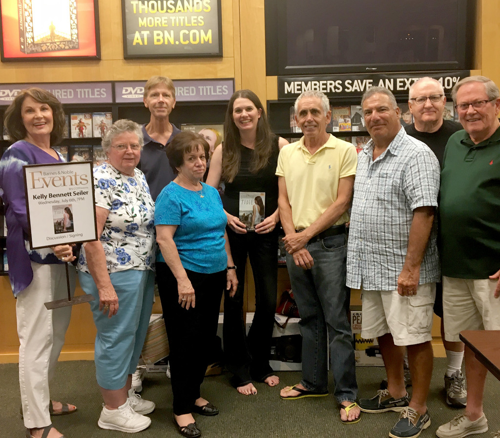 (above) Kelly Bennett Seiler, center top, is surrounded by teachers from the Clark district at her book signing of her first novel, Shifting Time, in the Clark Barnes & Noble on July 6. Friends, classmates, neighbors and faculty members came out to the event to support her.