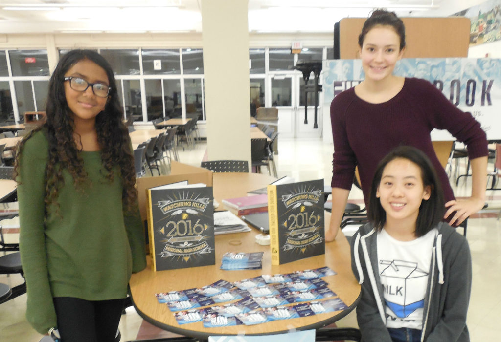 (above) Student staffers presented information the Watchung Hills Regional High School (WHRHS) Yearbook at Back to School Night, Thursday, Oct. 6. They are, standing left, Sophomore Isha Kasu of Warren Township, standing right Senior McKenzie Schuyler of Green Brook Township, and seated, Senior Emily Yan of Warren. Schuyler and Yan are editors. They said the Yearbook is a year-long project that includes interim deadlines each quarter on the way to the final product at the end of the school year.
